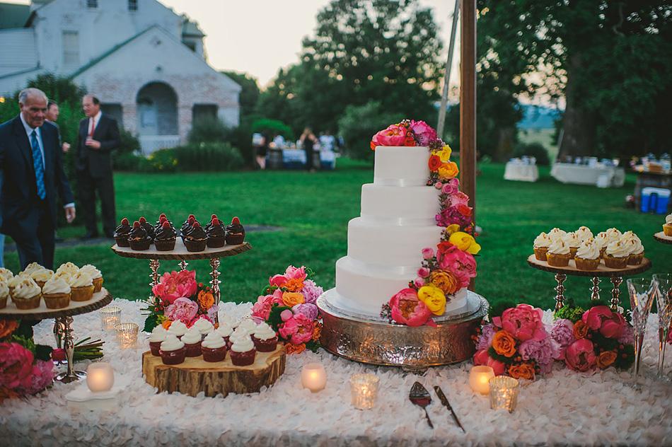 beautiful wedding cake and cupcakes