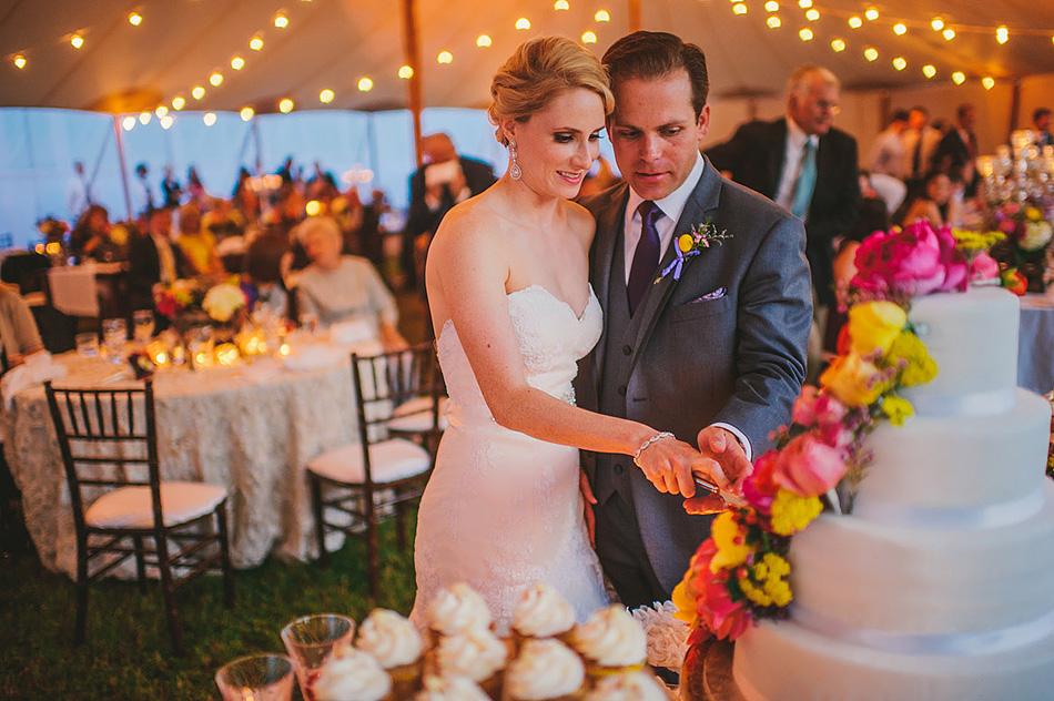 rustic outdoor wedding cake cutting