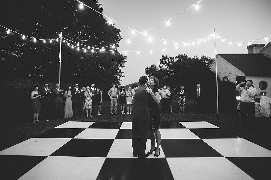 outdoor summer wedding reception mother son dance
