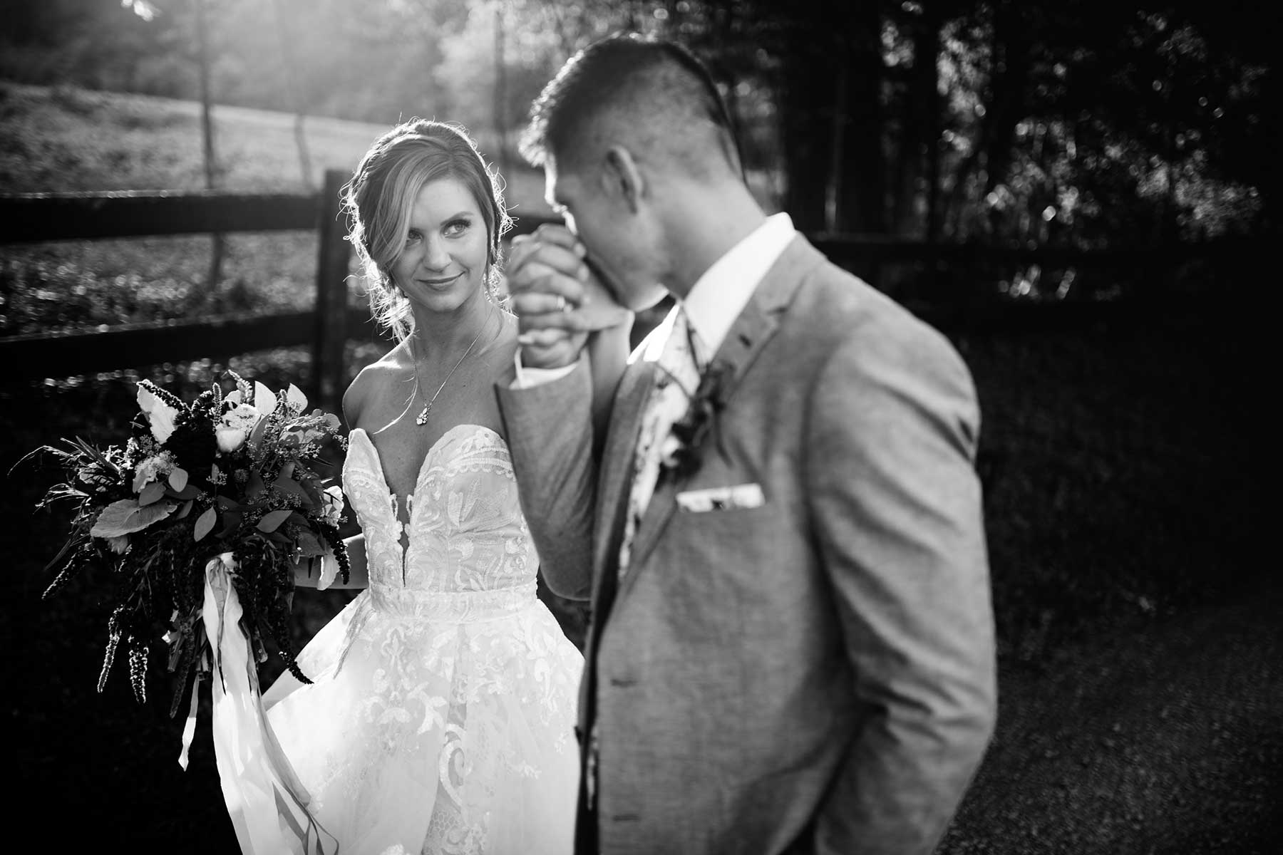 groom kissing brides hand