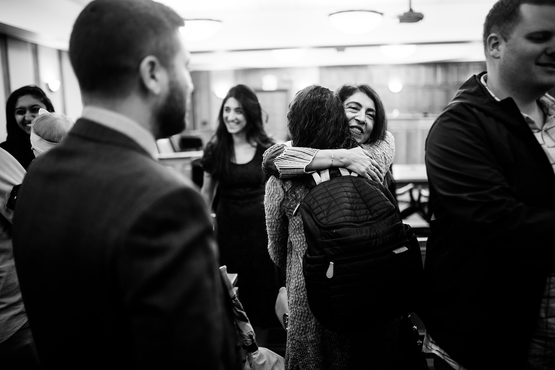 hugging at courthouse wedding