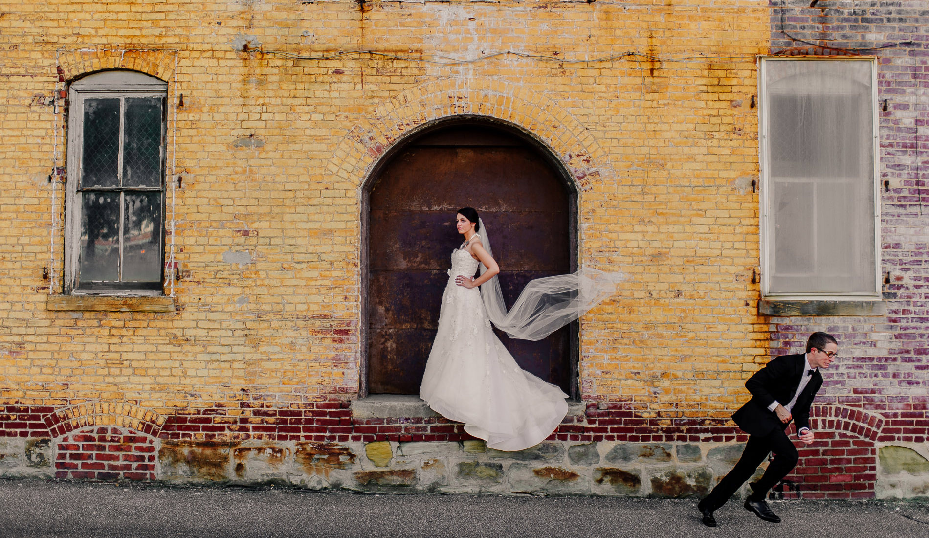 creative bride and groom portrait with groom running