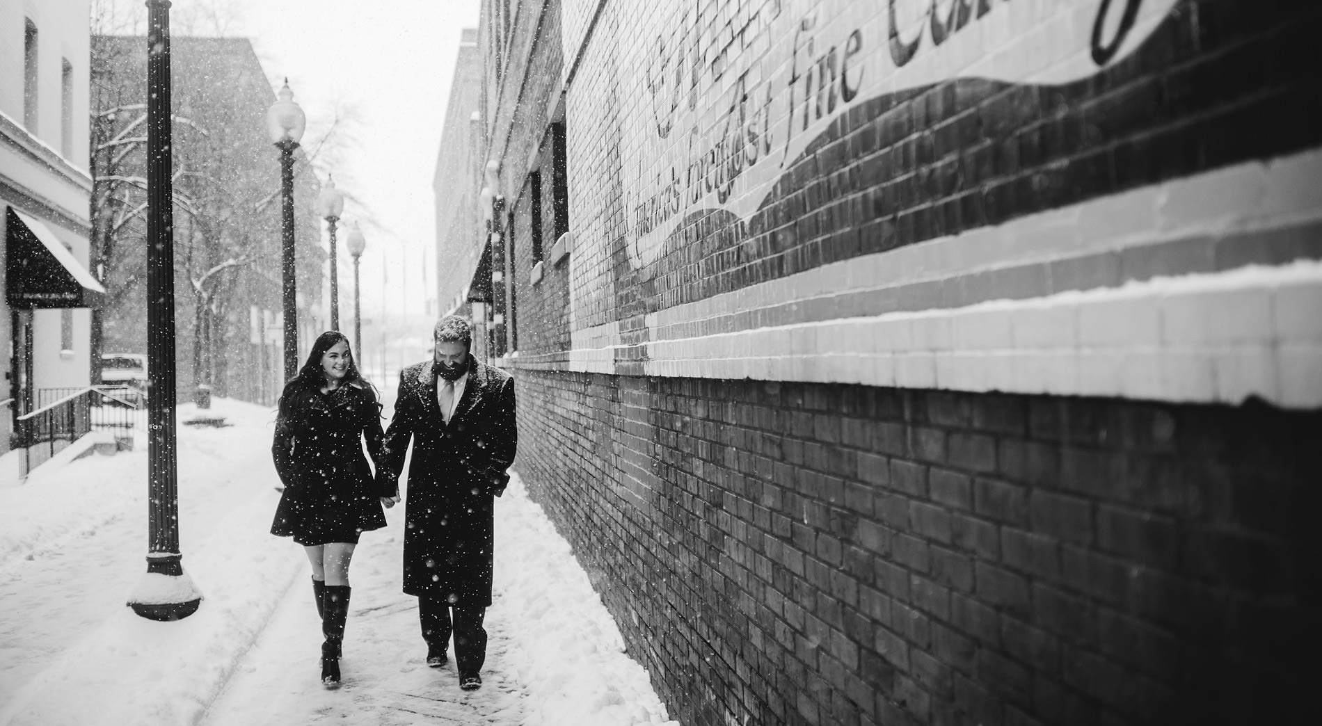 epic snowy downtown charleston engagement pics