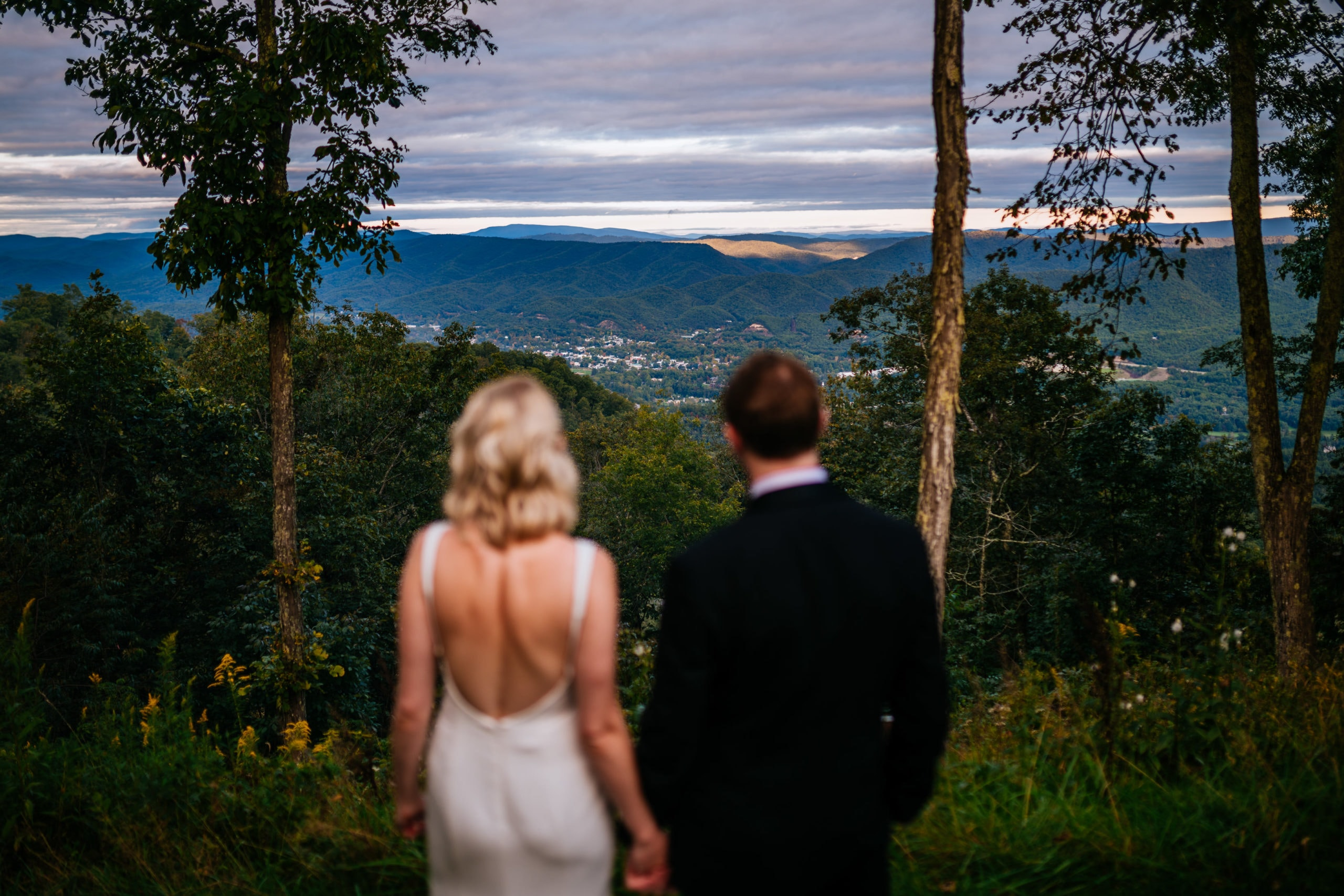 bride and groom looking out at greenbrier sporting club wedding