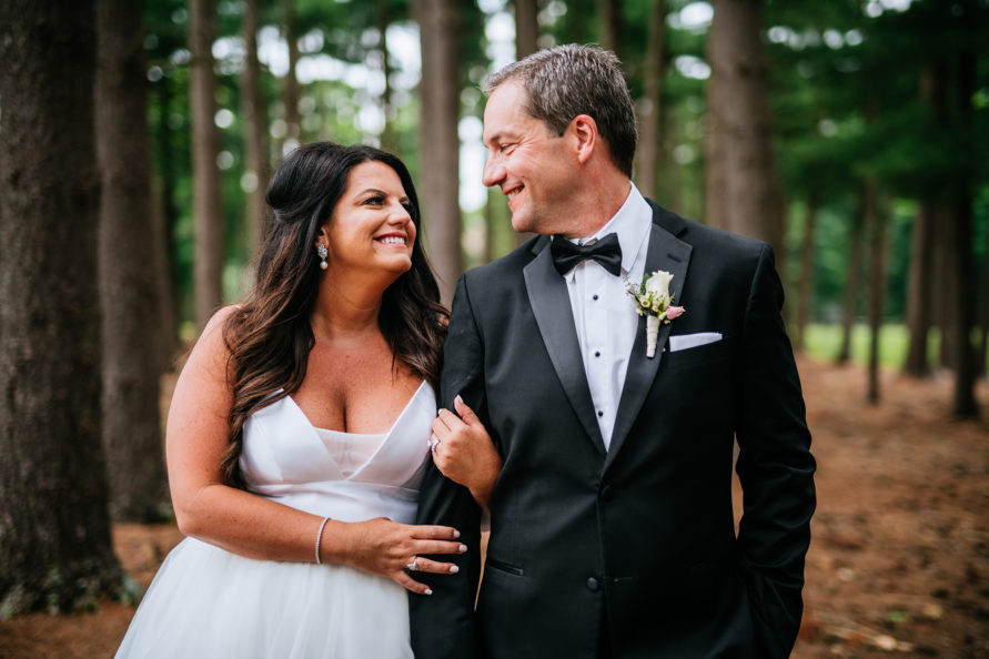 bride groom smiling at each other