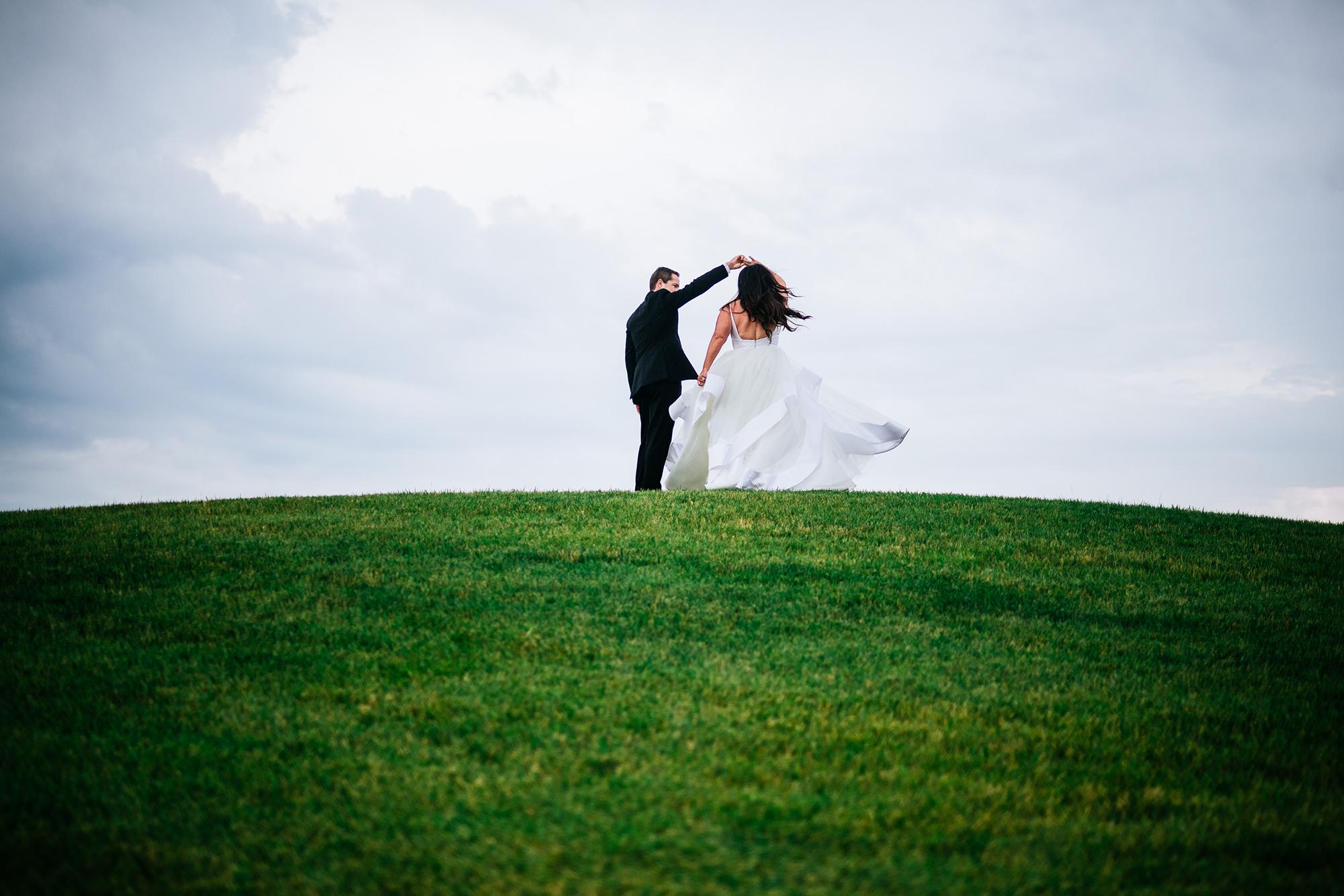 bride spinning groom