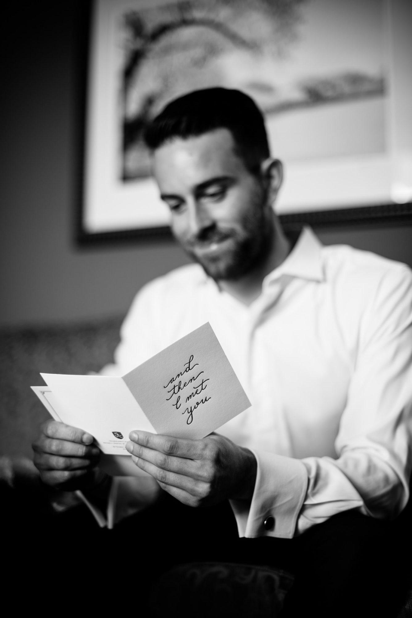 groom reading card