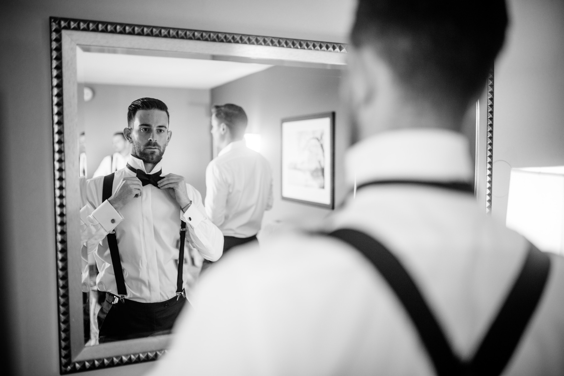 groom putting on bowtie