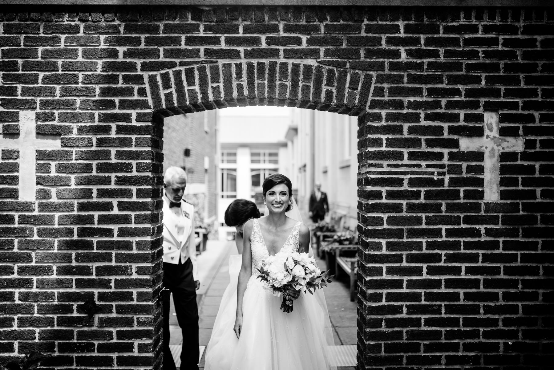 bride walking through archway