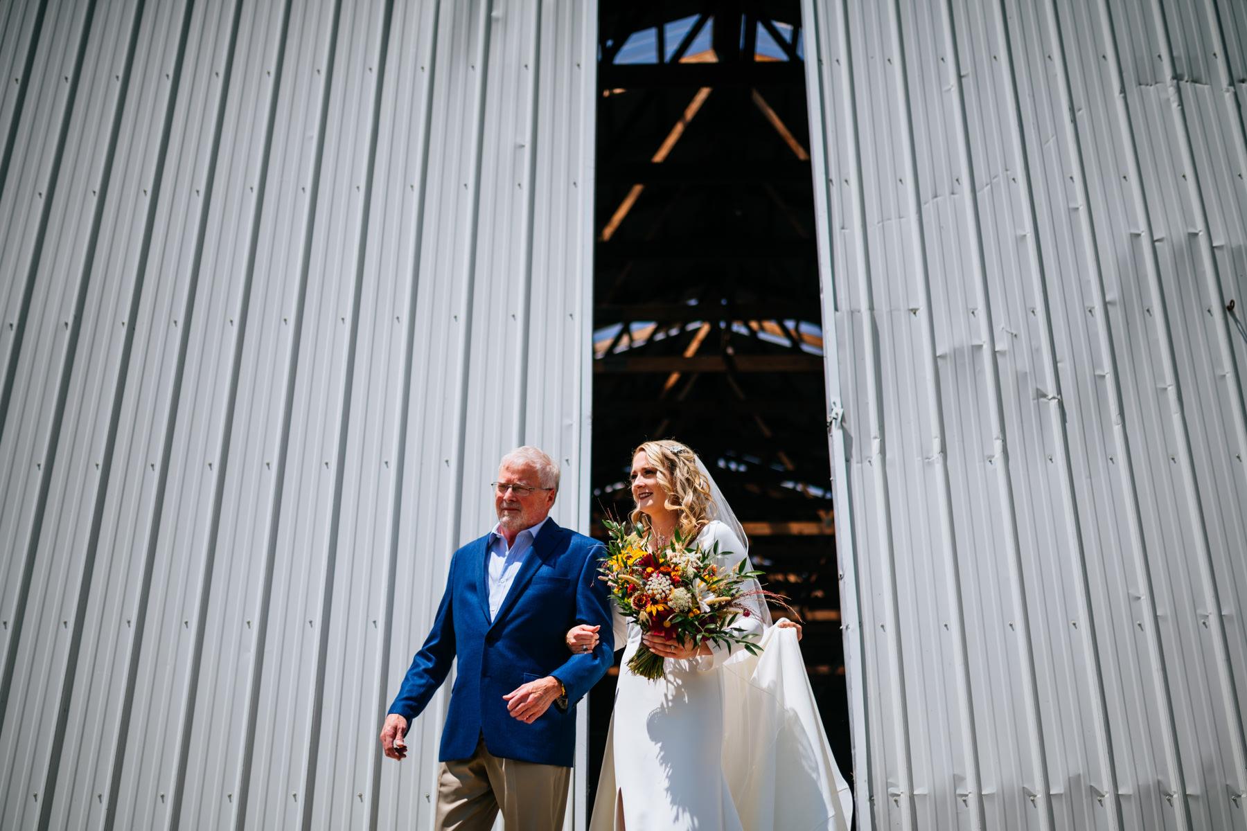 bride exiting barn