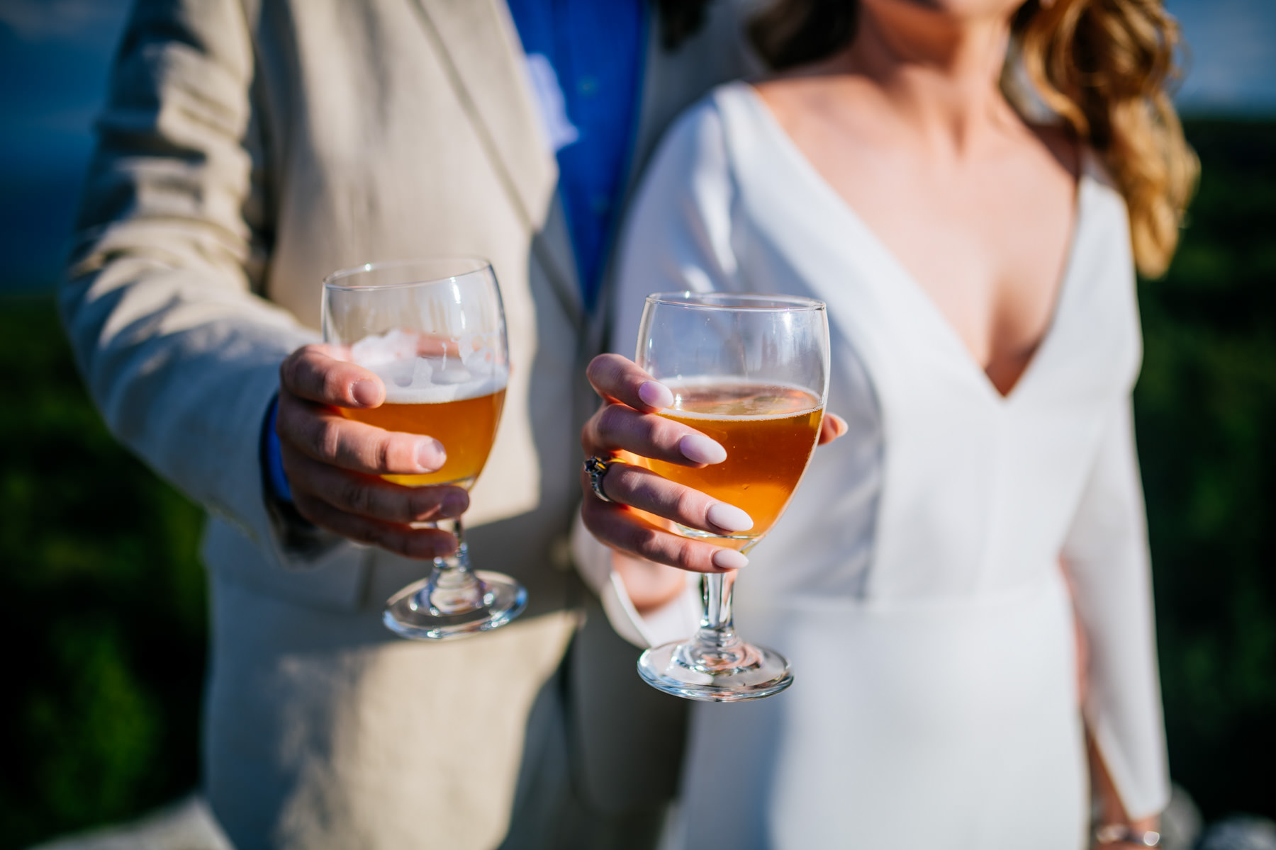 bride and groom with beers