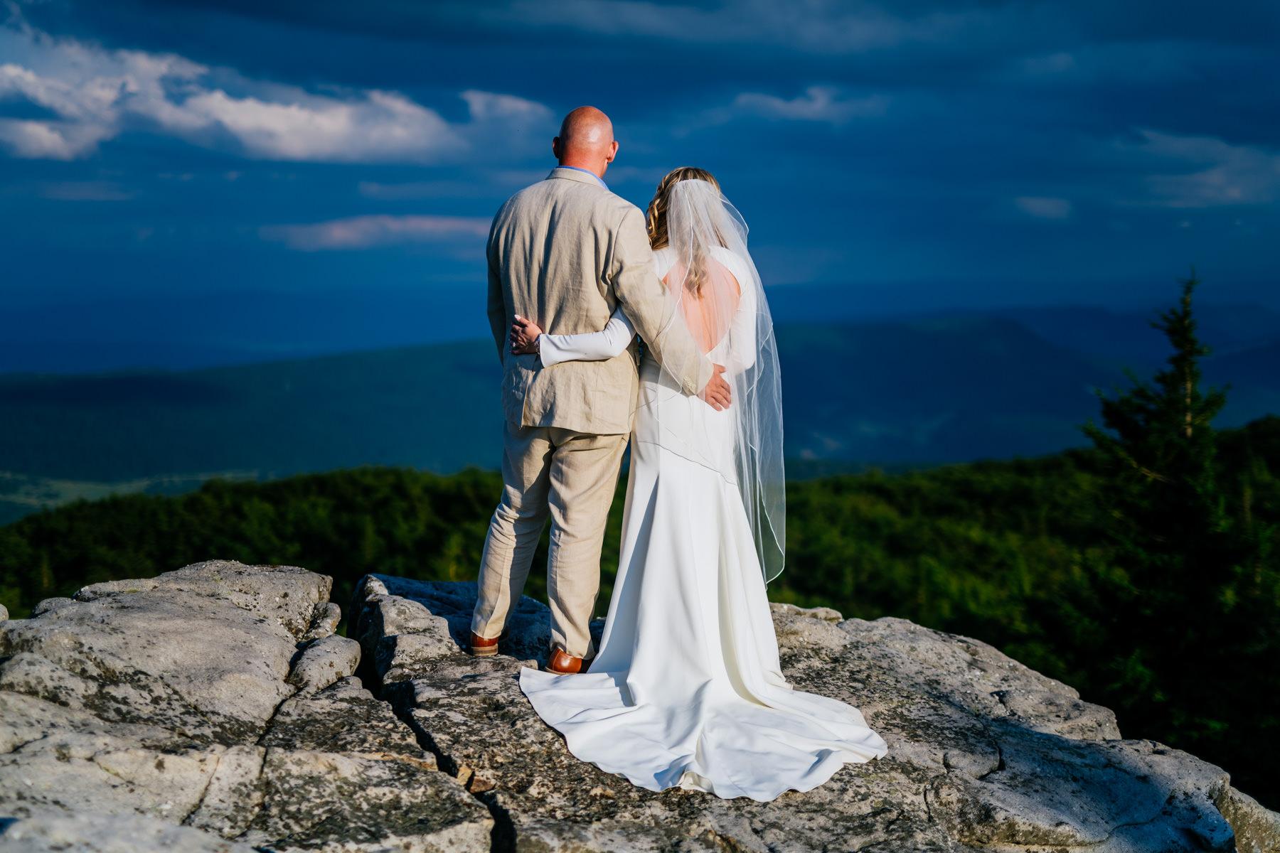 bride and groom overlooking cliff