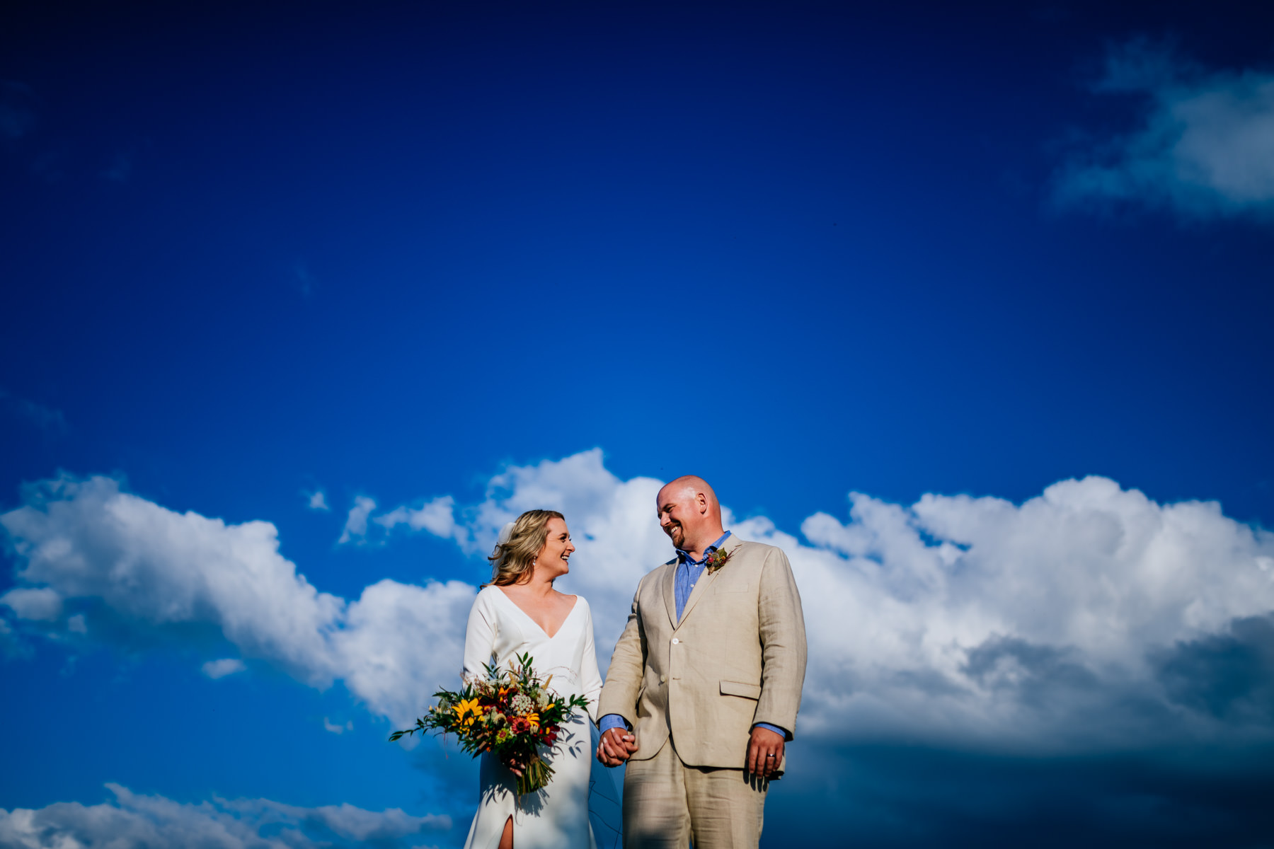 bride and groom in sky