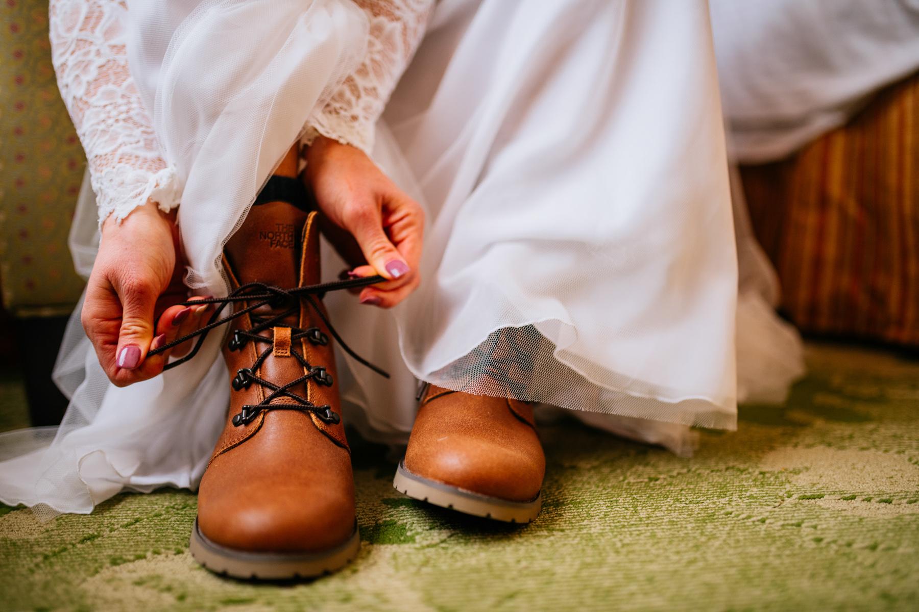 bride lacing up boots