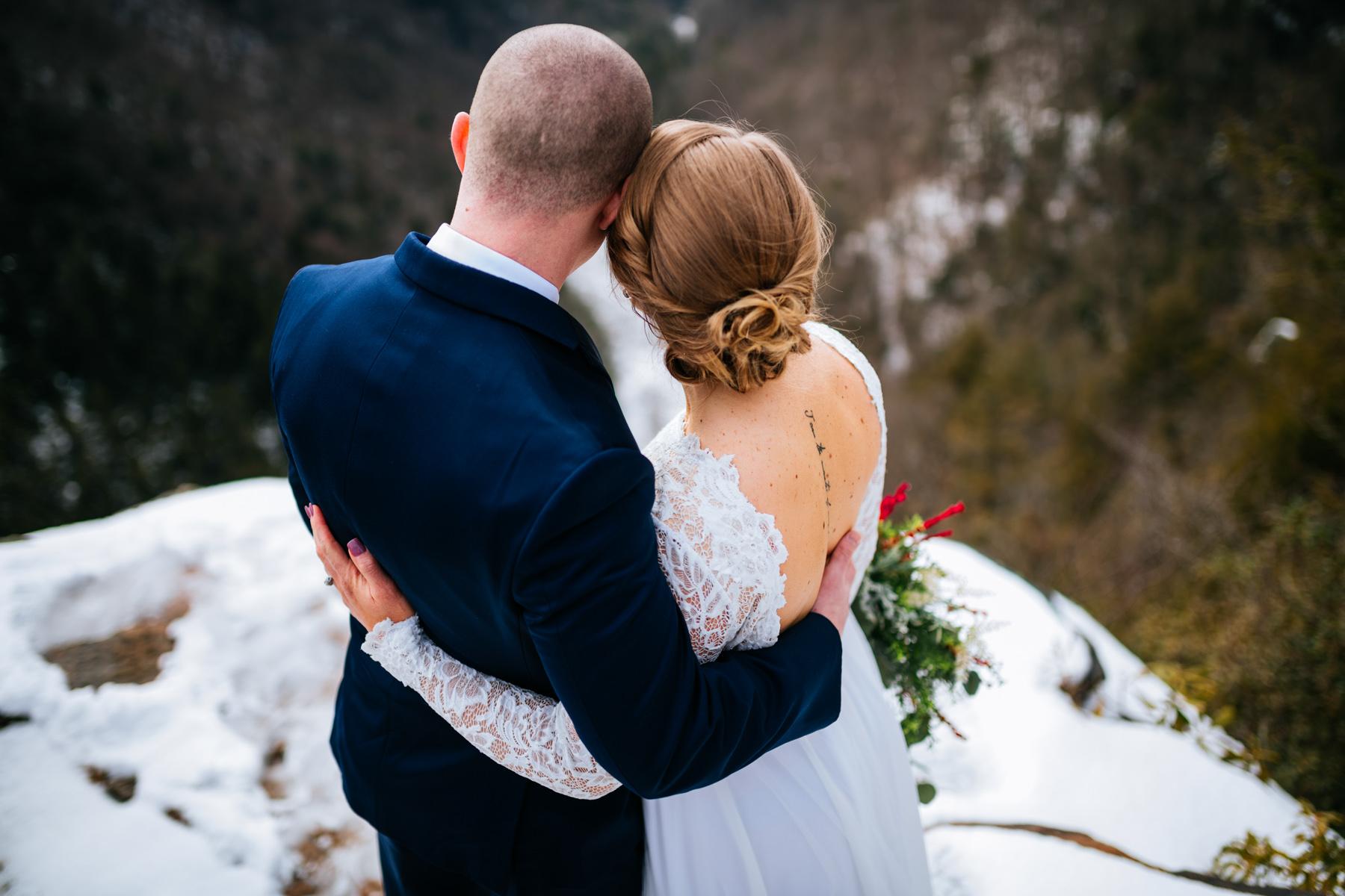 bride and groom backs turned
