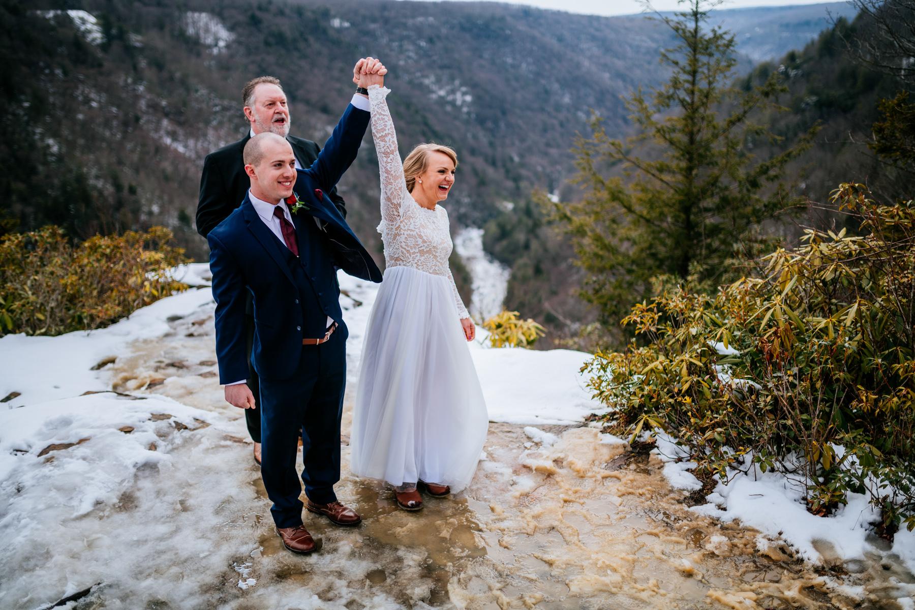 pendleton point wedding couple raising hands