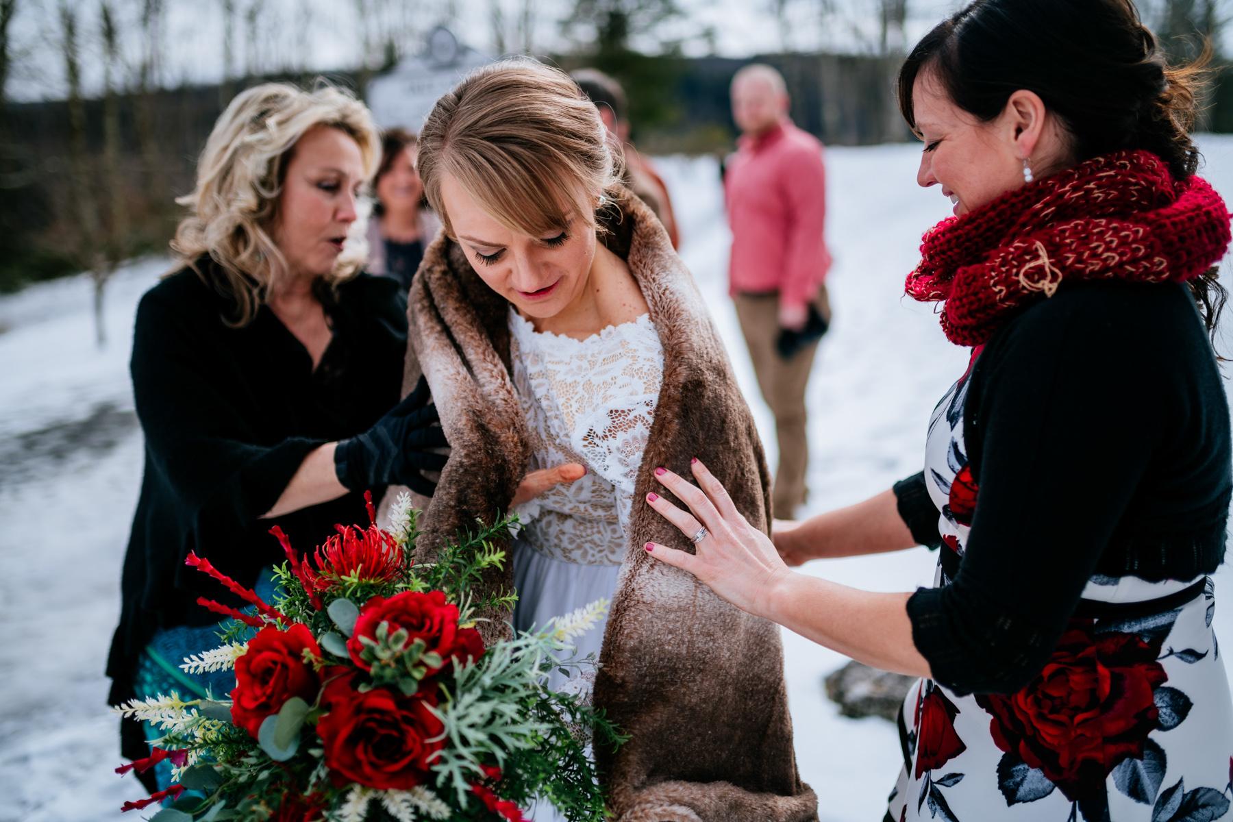 bride wearing a blanket