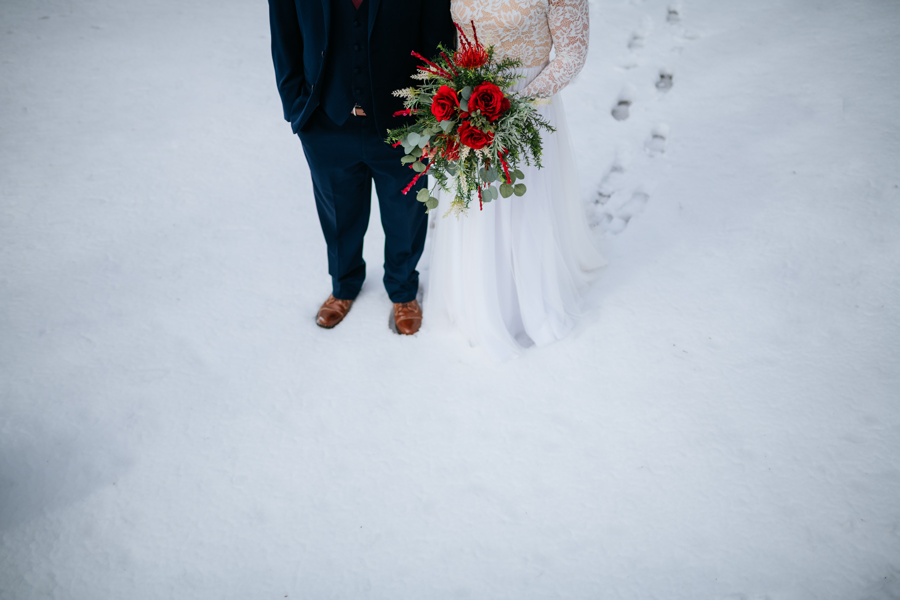 bride and groom snowy wedding portraits