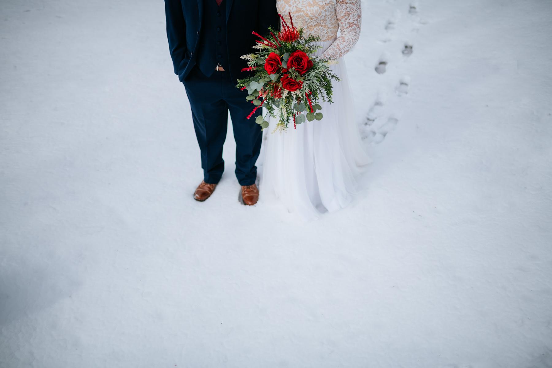 bride and groom snowy wedding portraits