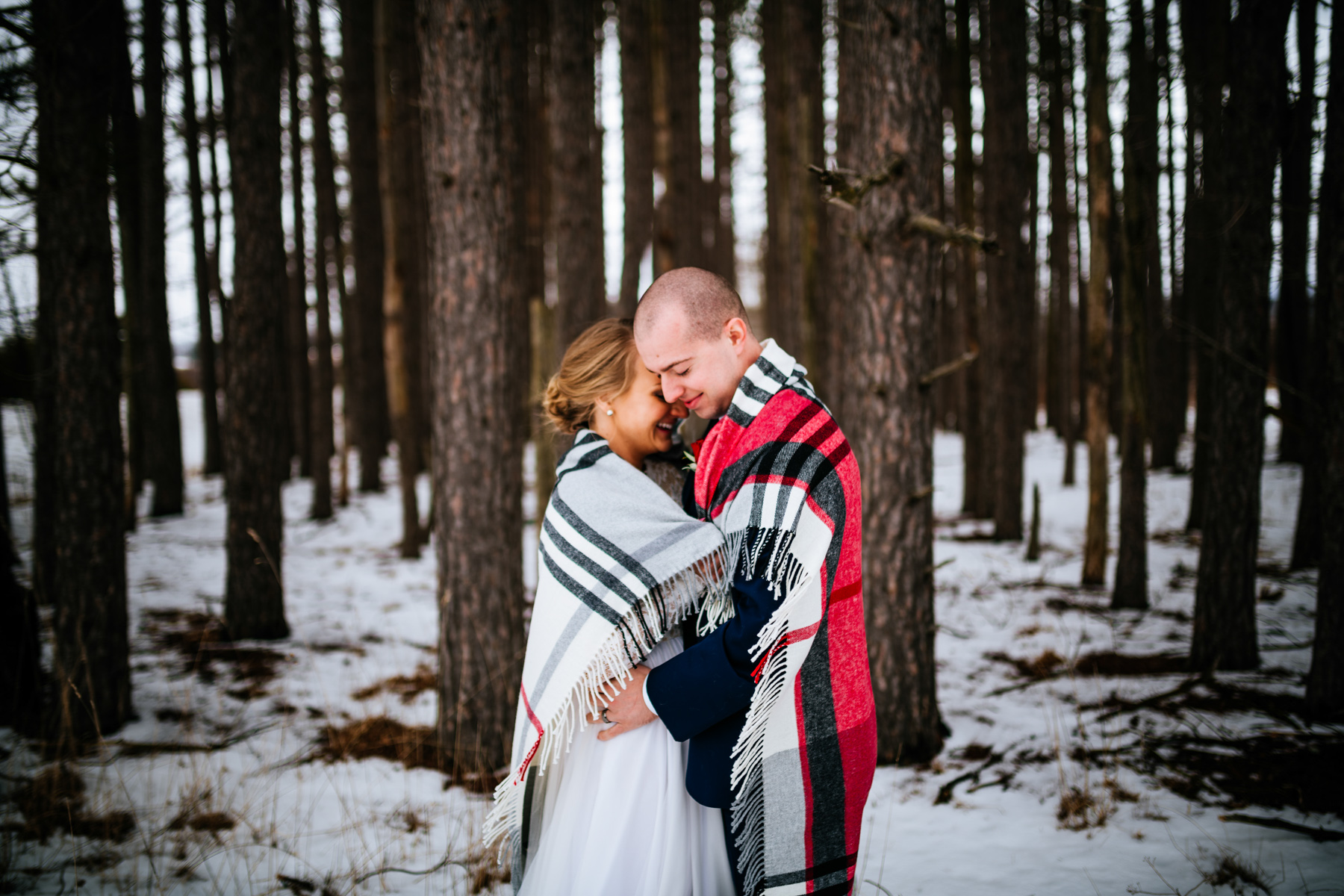 bride and groom under blanked at canaan valley