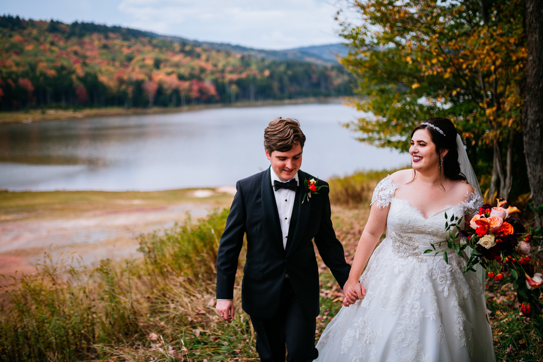 bride and groom walking snowshoe mountain resort wedding