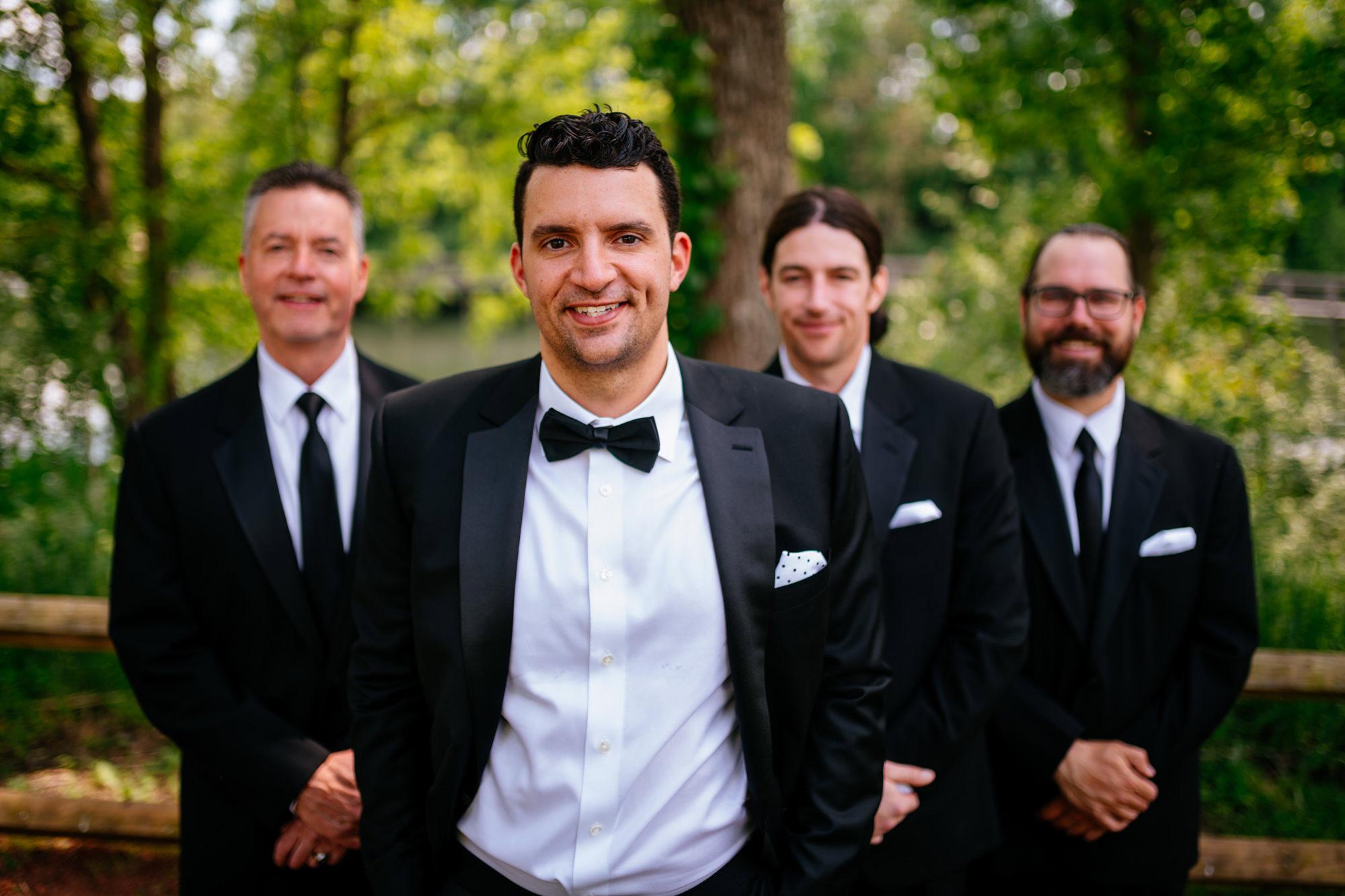 outdoor groomsmen portrait