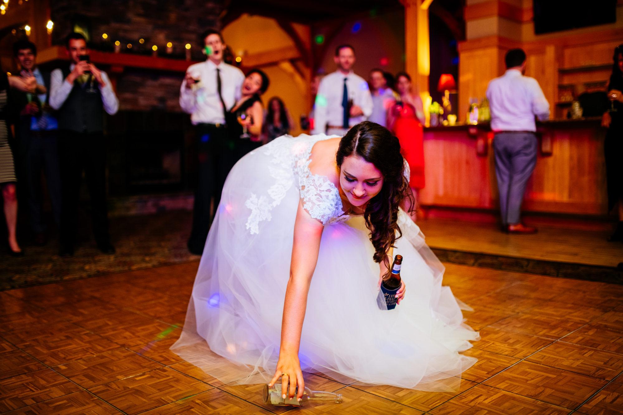 bride spinning bottle on dance floor