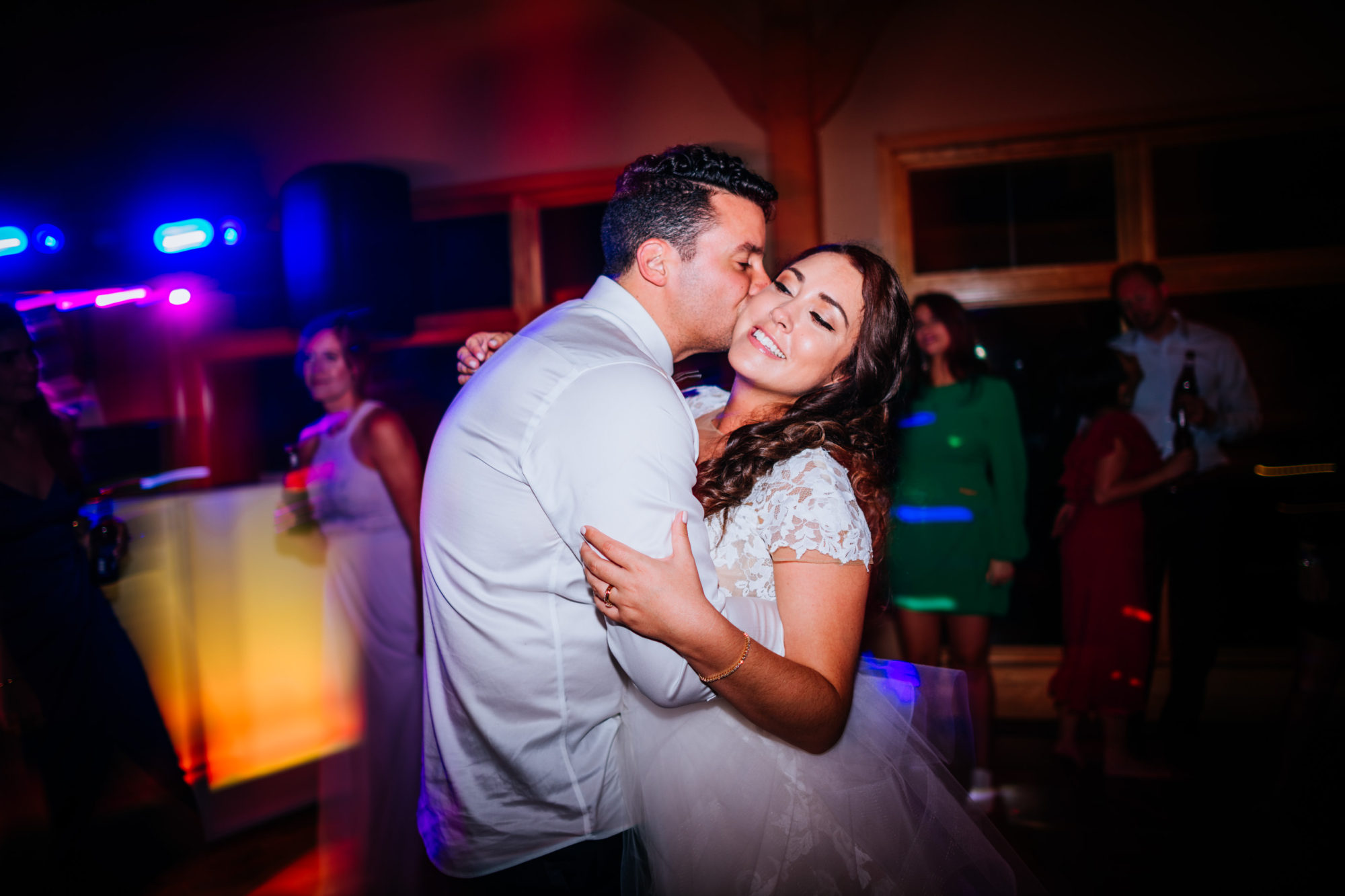 groom kissing bride during reception