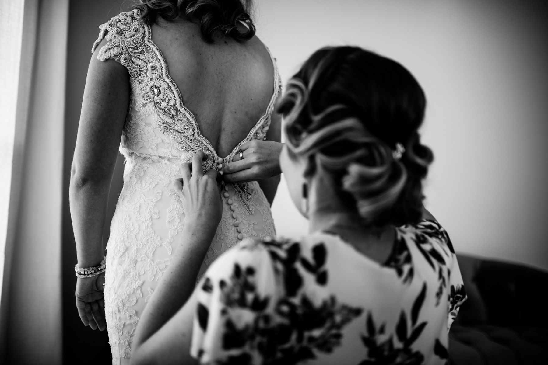 bride dress getting buttoned