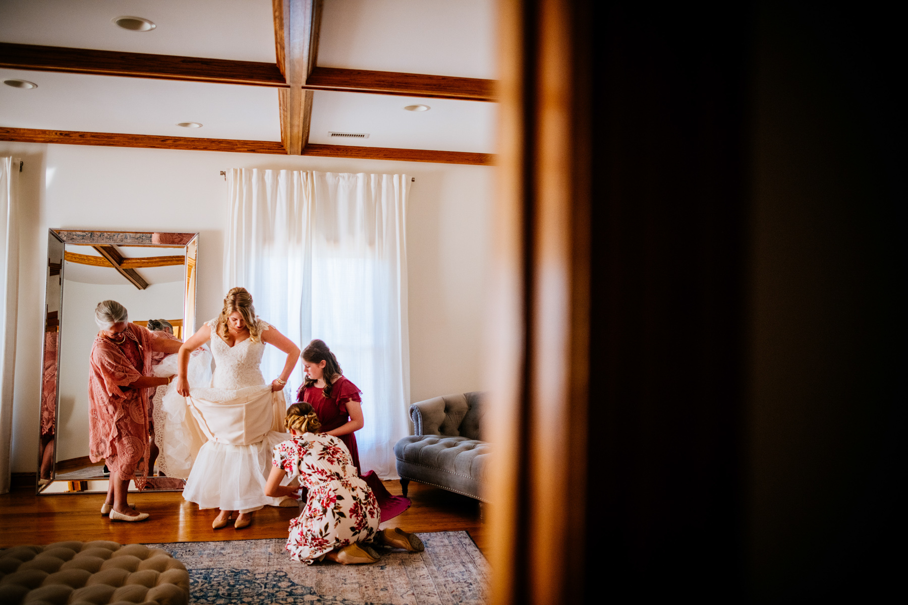family helping bride get dressed
