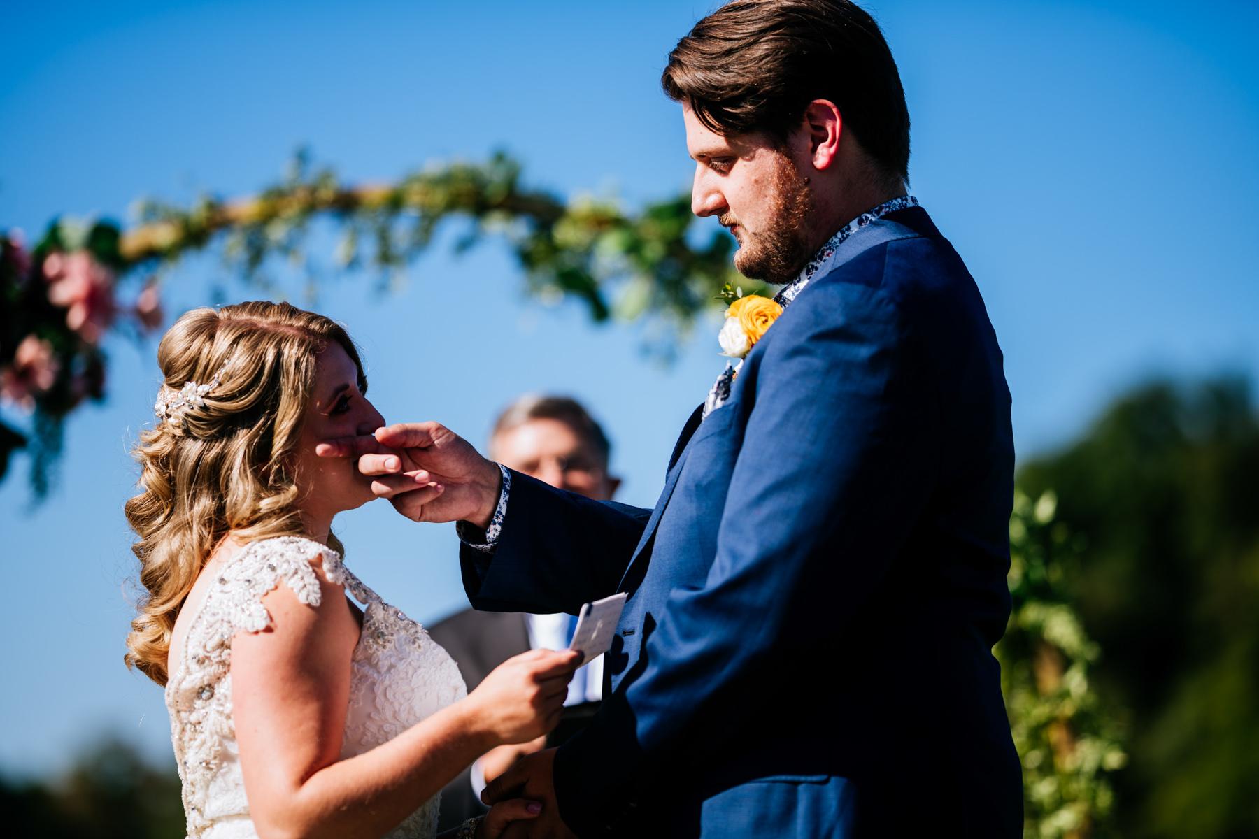 groom wipes brides tear