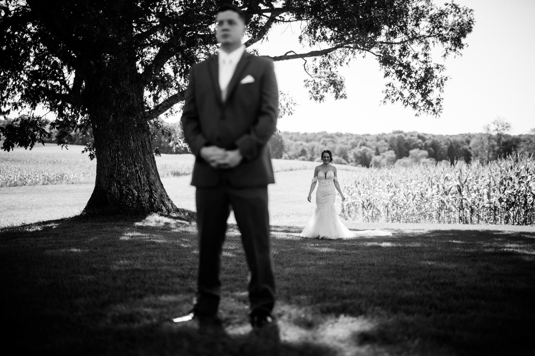 first look white barn at lucas farm wedding