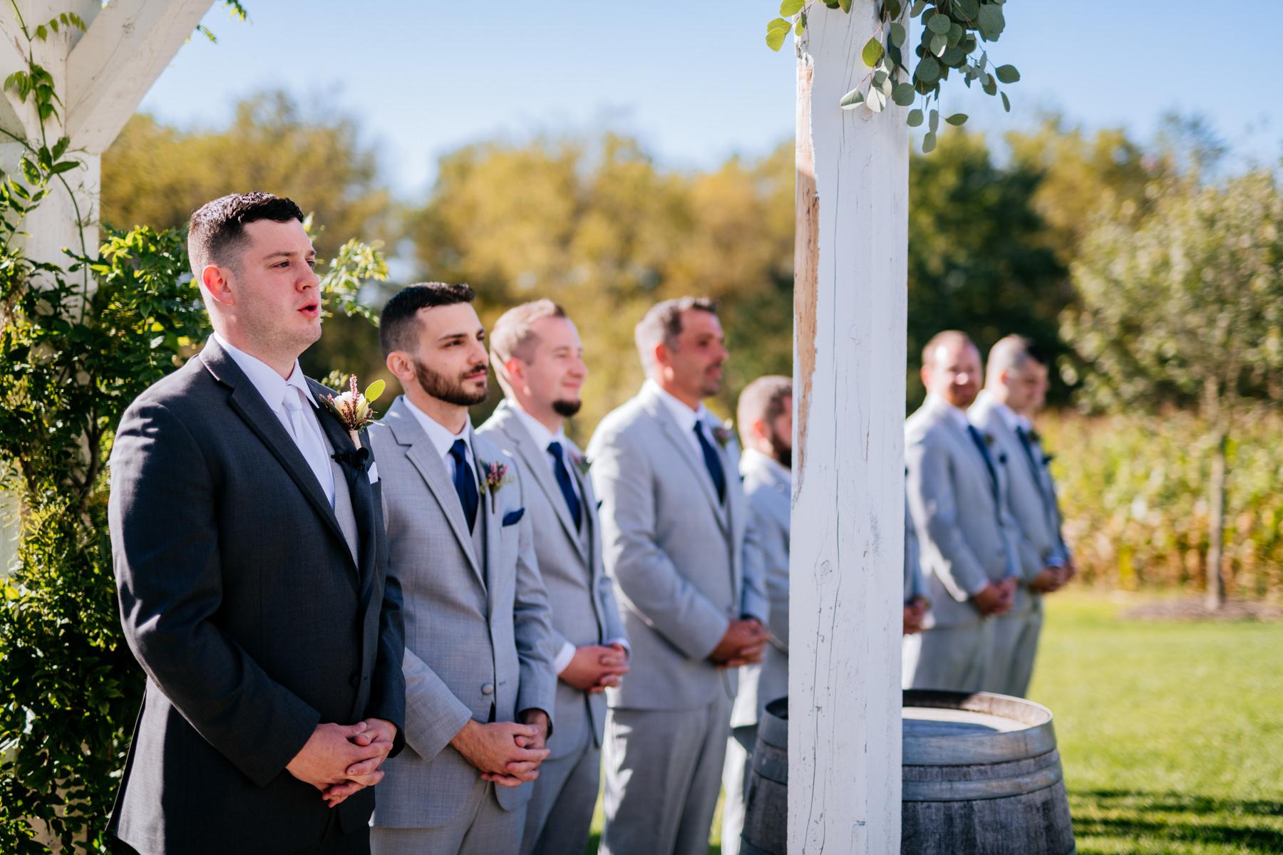emotion groom during wedding ceremony