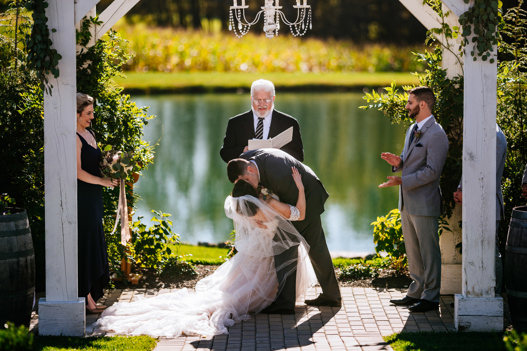 groom dips bride during first kiss