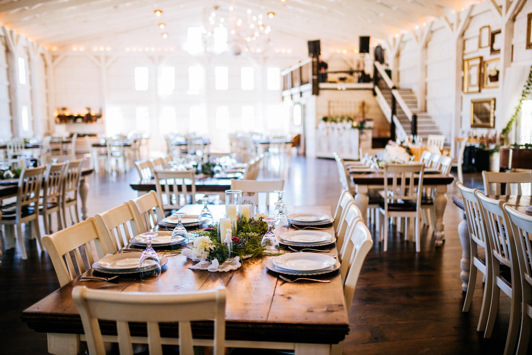 table setup white barn at lucas farm wedding