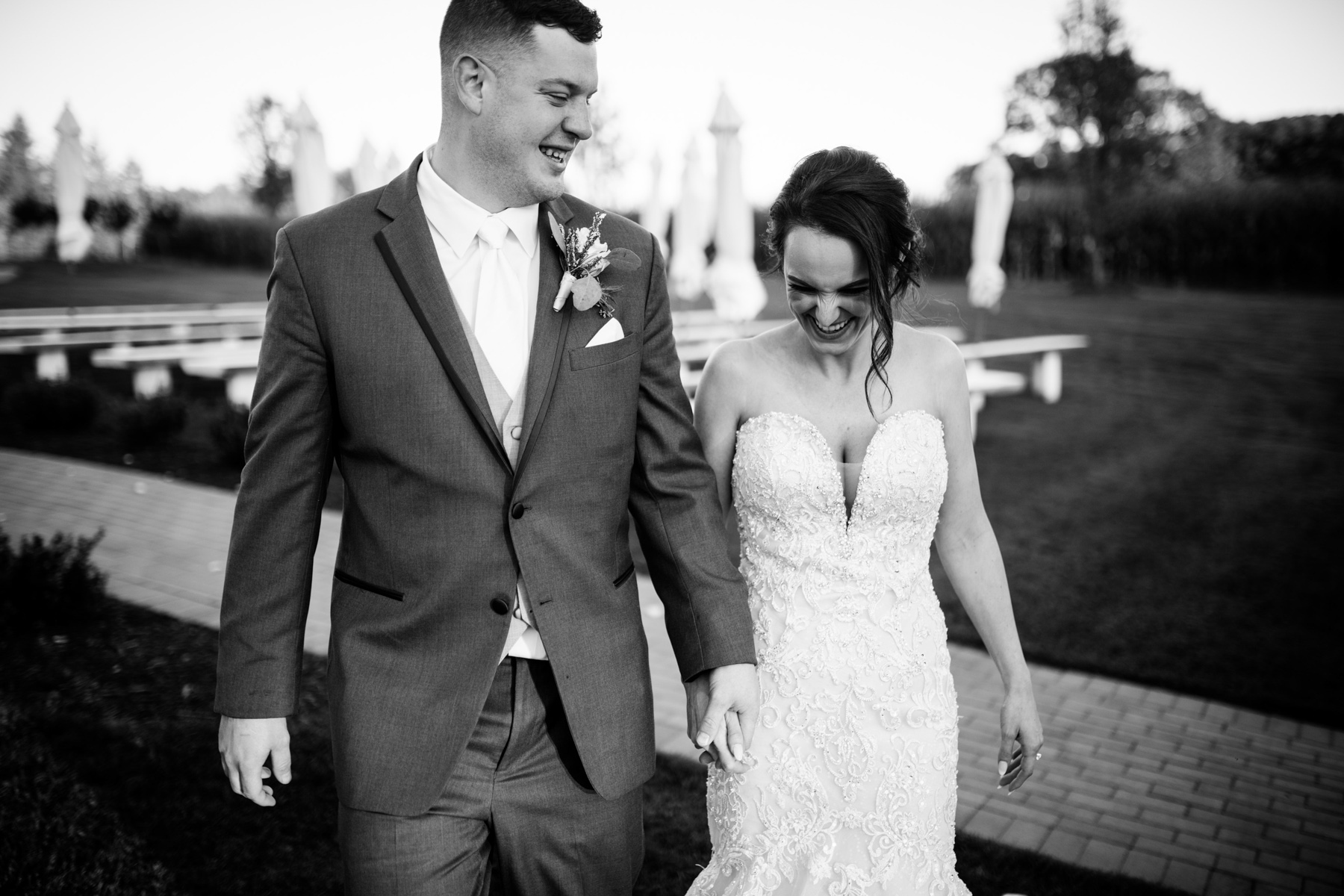 black and white bride and groom walking and laughing