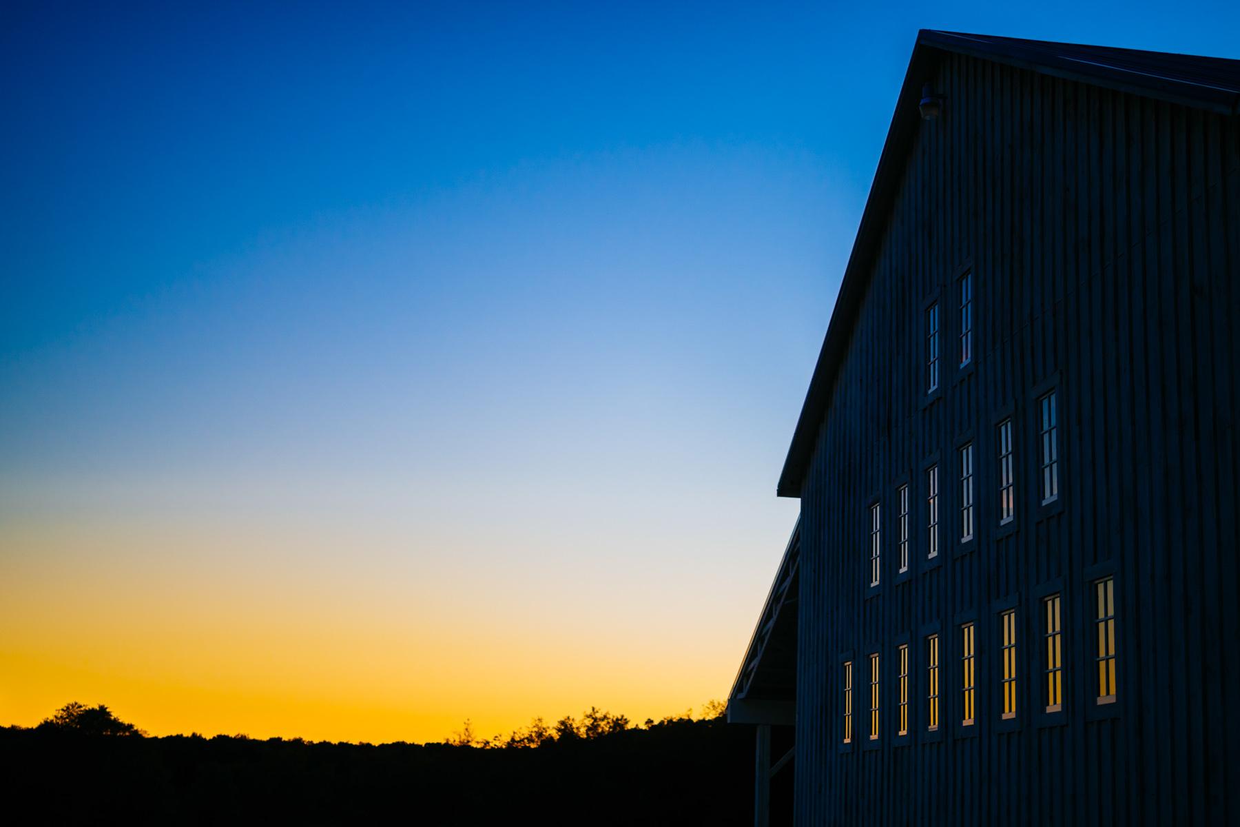 sun set at white barn at lucas farm wedding