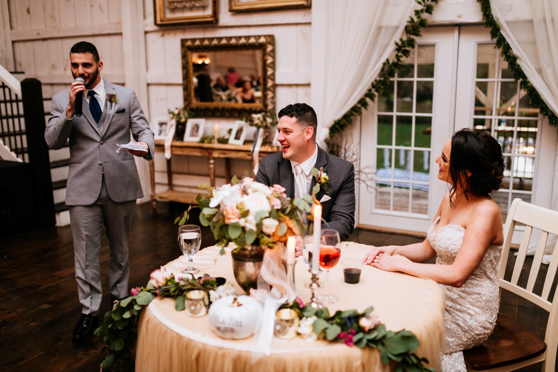 wedding toasts at white barn