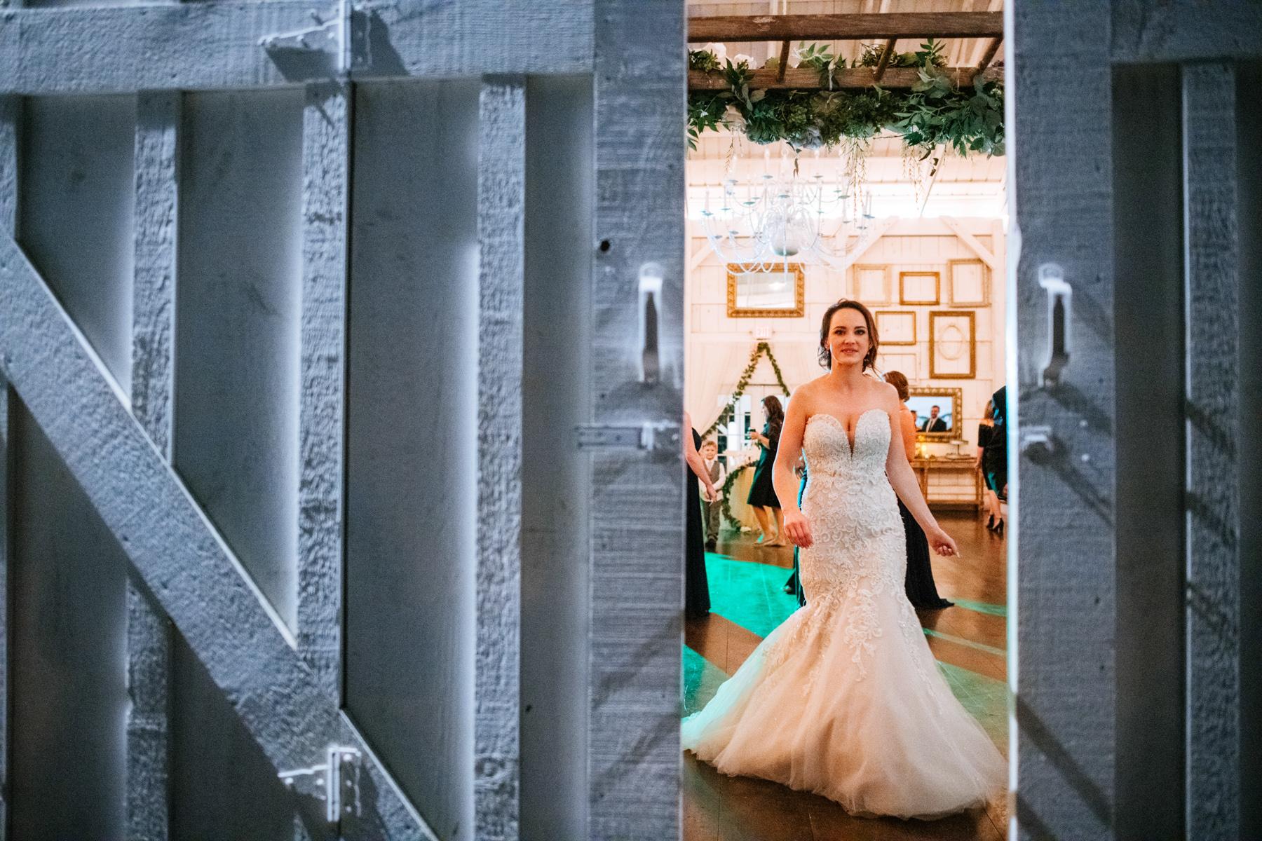 bride dancing through doorway