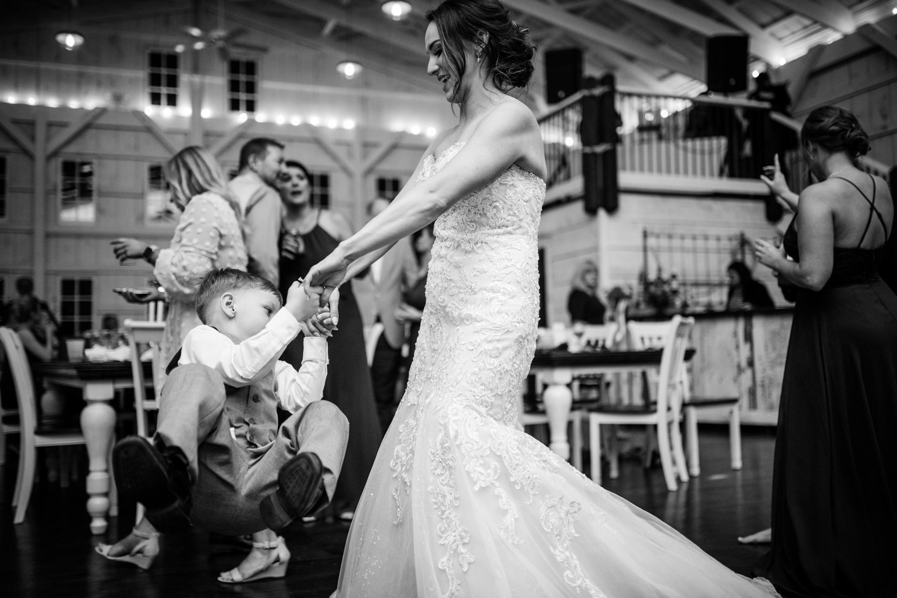 bride dances with kid