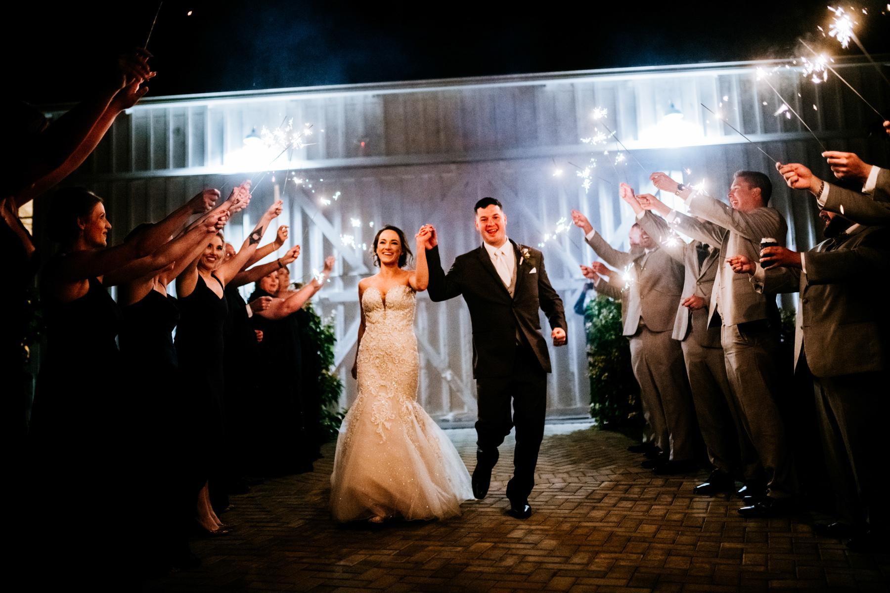 bride and groom sparkler exit white barn at lucas farm wedding