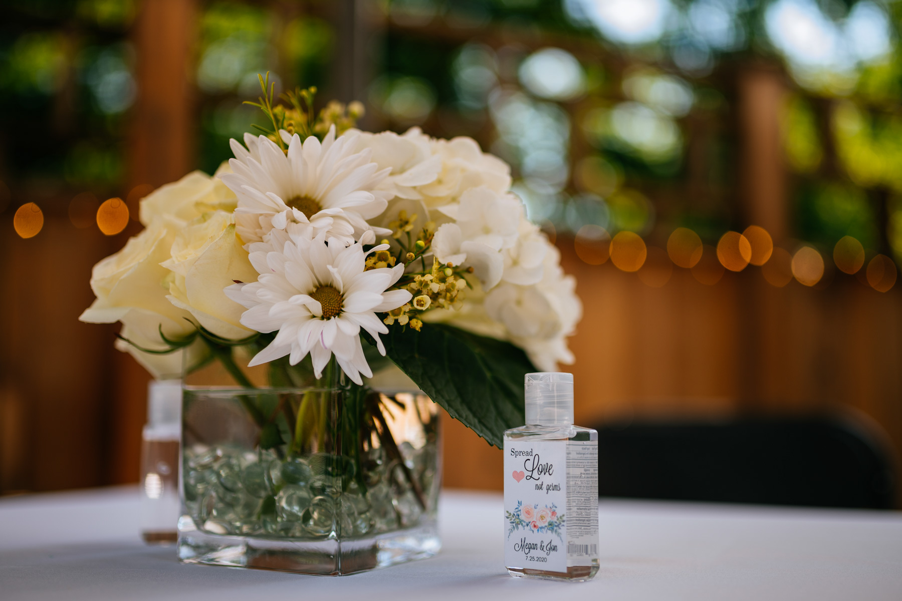 wedding hand sanitizer and flowers