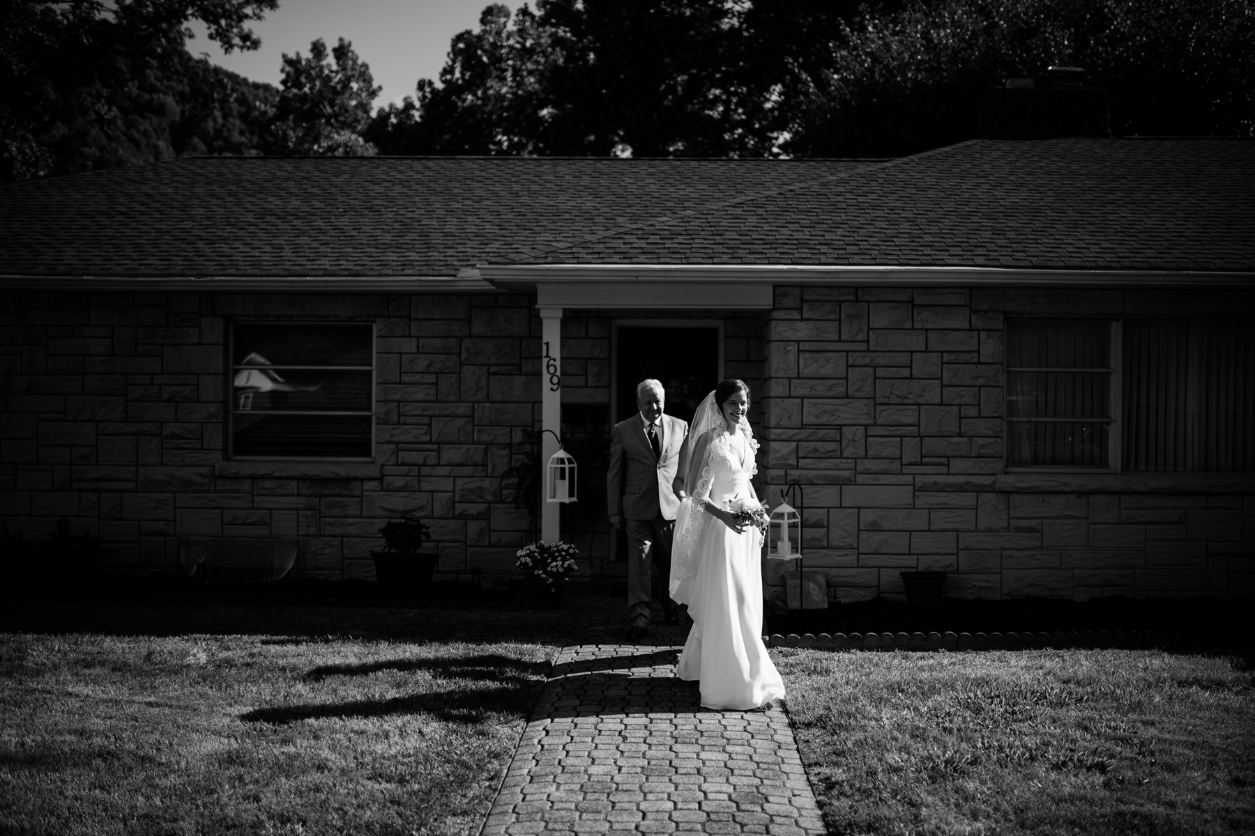 bride walking out of house