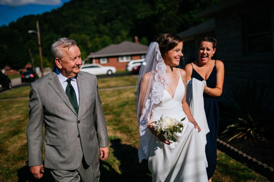 bride and dad walking to wv backyard minimony