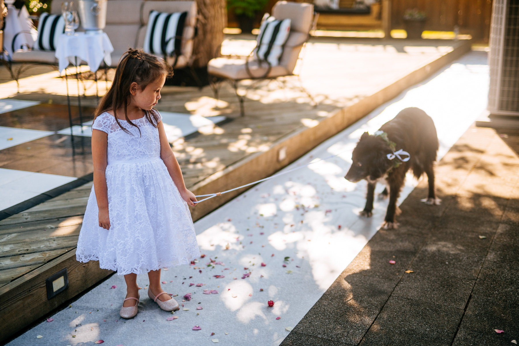 little girl walking down aisle with dog