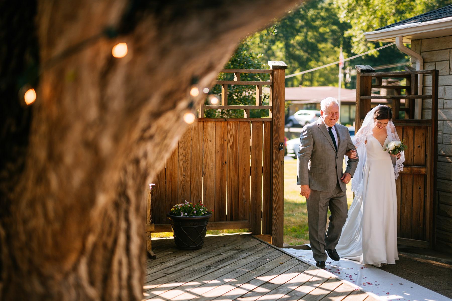 bride and dad entering wv backyard minimony