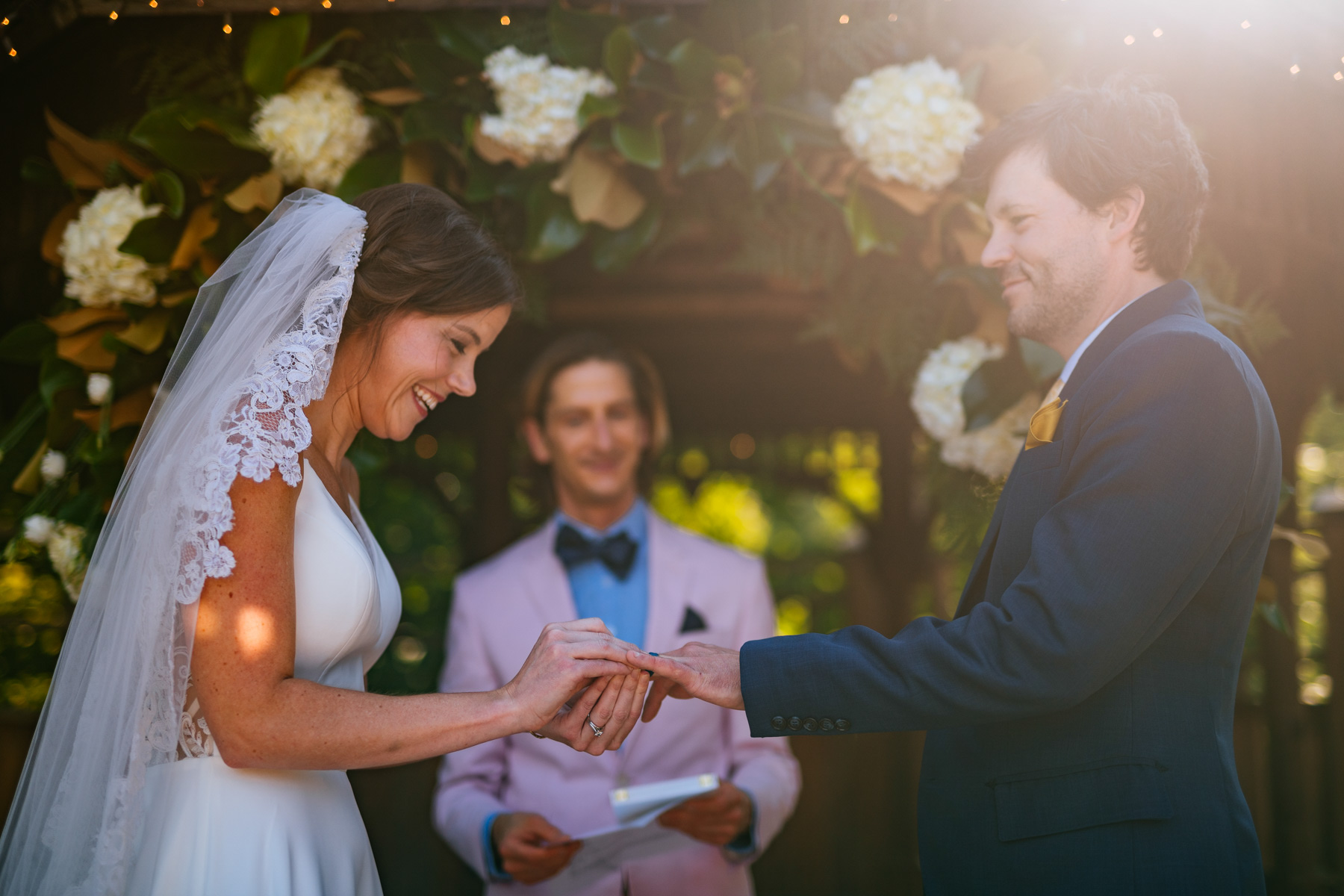 bride puts ring on during wv backyard minimony