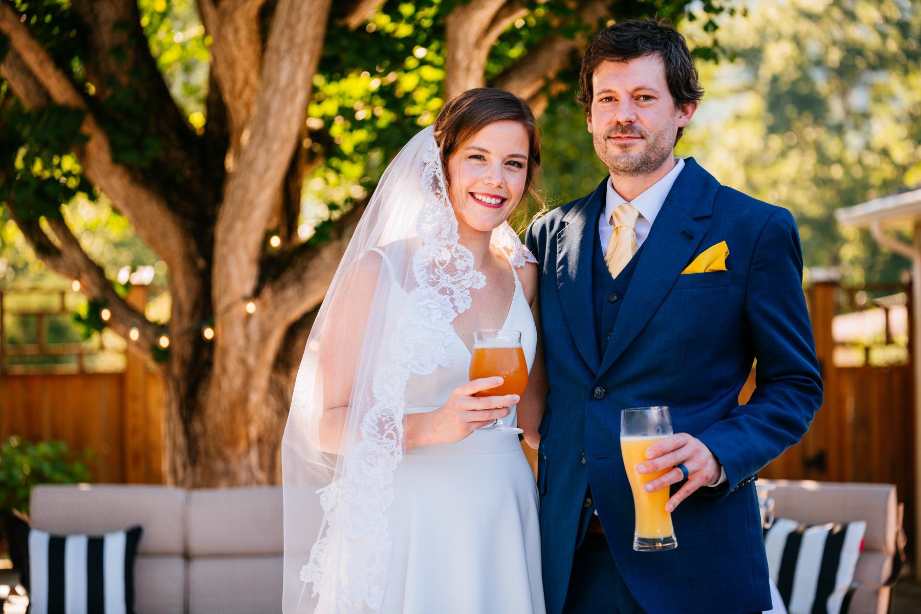 bride and groom toast beers