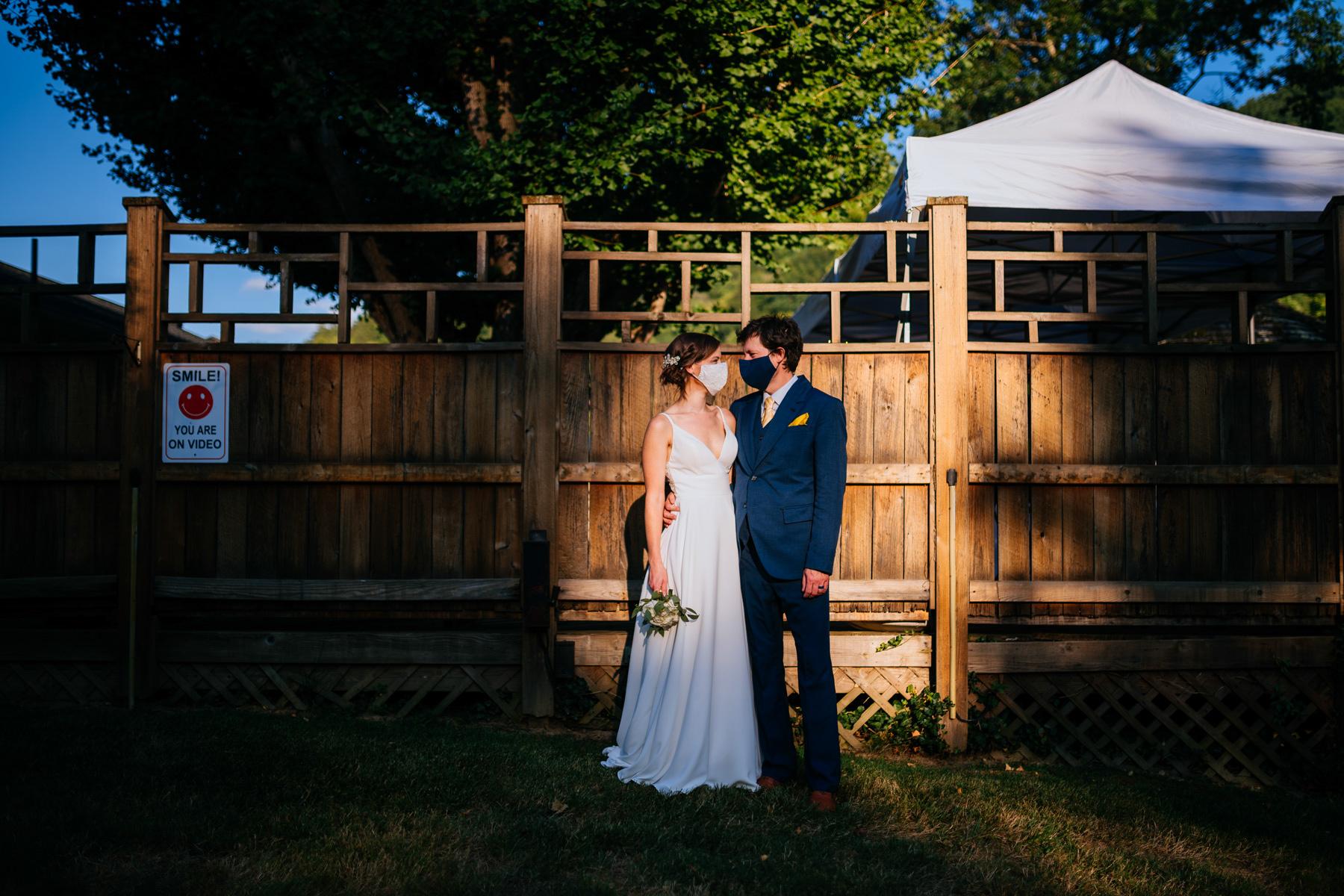 covid coronavirus bride groom wearing masks wv backyard minimony