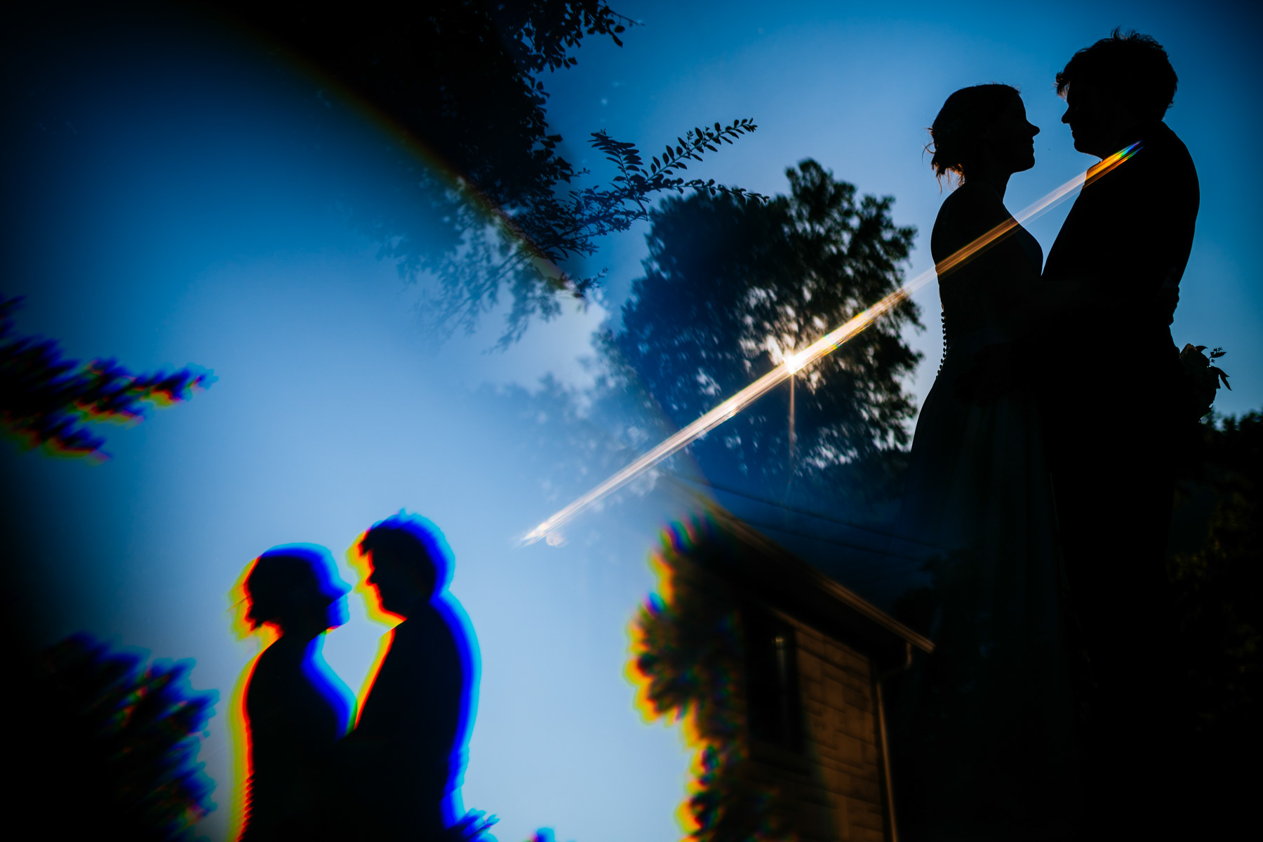 bride and groom silhouette reflection